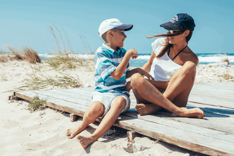 Mom and son having morning meetings on the beach at home